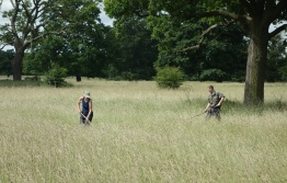 Jayne & Neil raking out the paths