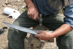 Peening the scythe blades
