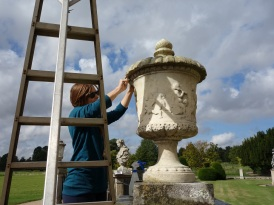 Tabatha cleaning the marble urn