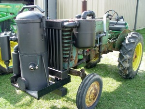 Wood gas generator running a tractor