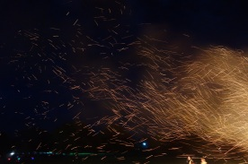 Sparks dancing in the night sky
