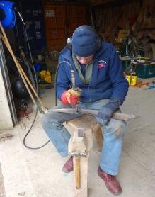 John cleaning the scythe blades