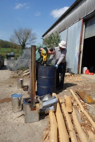 Jim and Alistair working on the charcoal retort