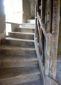 The original stair case with the later added internal walls