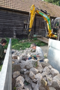 Loading the excess concrete for the farm track